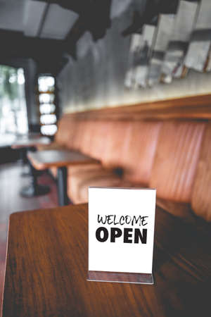 Come in we're open  in cafe owner open startup with cafe shop Stock Photo