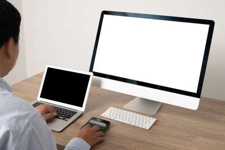 young man working Businessman using a desktop computer of the blank screen Foto de archivo