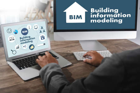 BIM Business team hands at work with financial reports BIM - Building information modeling  and a laptop Reklamní fotografie