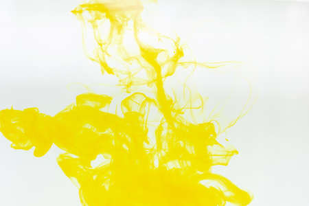 Ink in water yellow on white background. Banco de Imagens