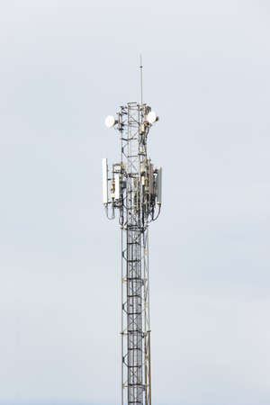 Telecommunication tower of 4G and 5G cellular tower with antennas isolated on white background.