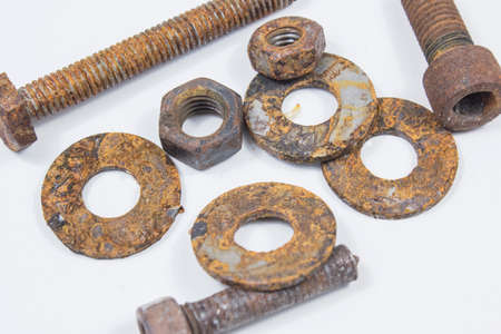 Nut and Bolts Rusty Screws on white Background.These old metal parts surface.
