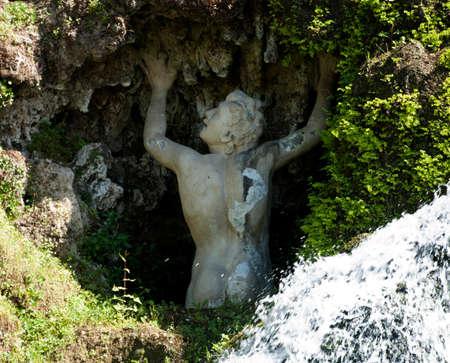 Statue in Grotto Stock Photo