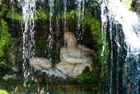 Statue behind Waterfall