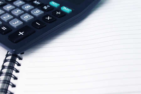 Calculator on documents Stock Photo