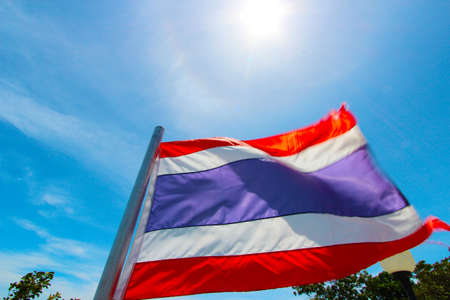 Image of waving Thai flag of Thailand with blue sky background Stock Photo - 21021554