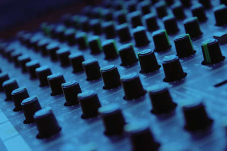 equalizer sliders: Mixing board close up