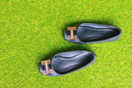 lacing sneakers: shoes in green grass Stock Photo