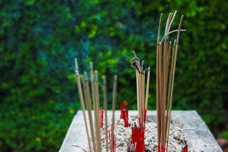 Incense sticks in ashes bucket Stock Photo - 29207662