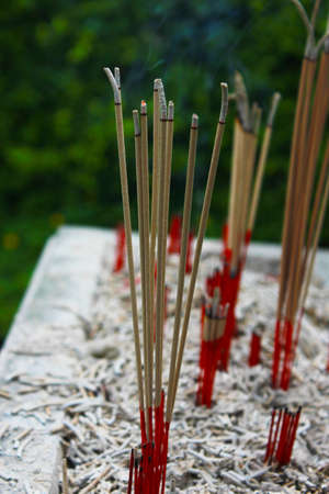 Incense sticks in ashes bucket Stock Photo - 29207841