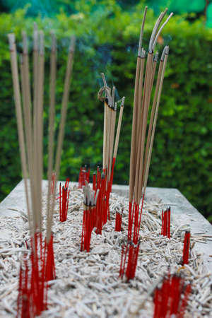Incense sticks in ashes bucket Stock Photo - 29207845