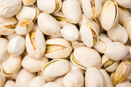 Close up of fresh pistachios. Whole background.