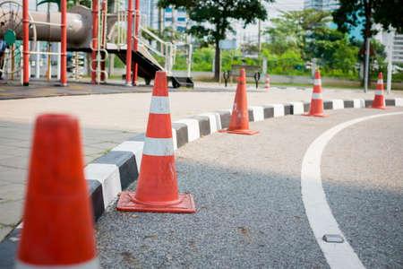 orange traffic cone on the road