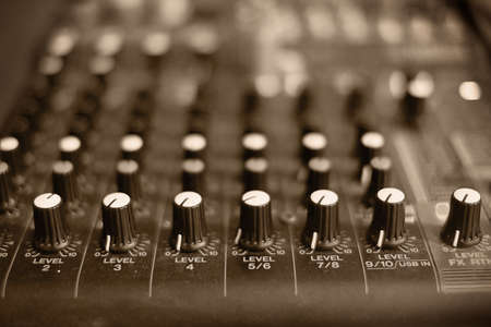 Mixing audio on desk for music with lighting effect,entertainment themes