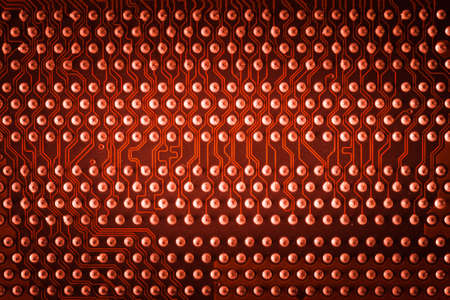 vivid red pcb board integrated circuit motherboard computer parts abstract background Stock Photo