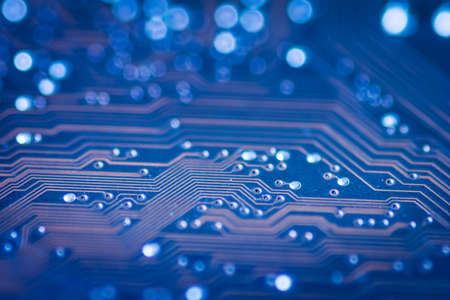 blue pcb motherboard with chip microchip background Stock Photo