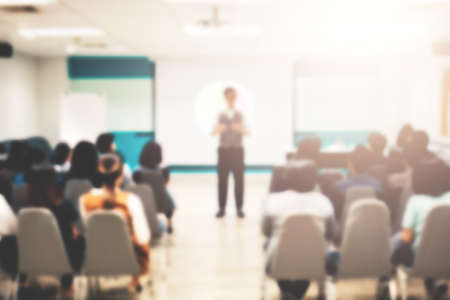 Young male business coach explaining to group of trainees concept of successful marketing campaign standing near board, smart student making report about coursework planning Banco de Imagens - 92495817