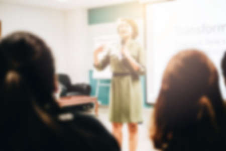 Blurred view of people at business training