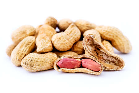 Dried peanuts in closeup. peanuts isolated on white background.seed Nut Banco de Imagens - 131441616