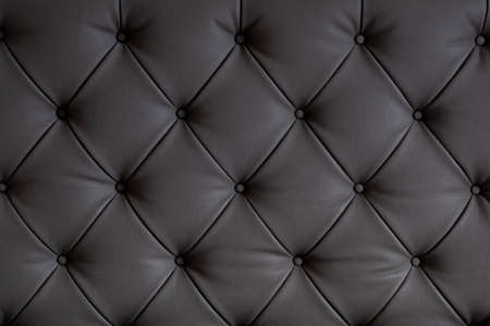Luxurious black leather chesterfield texture furniture with buttons Banco de Imagens - 131442422