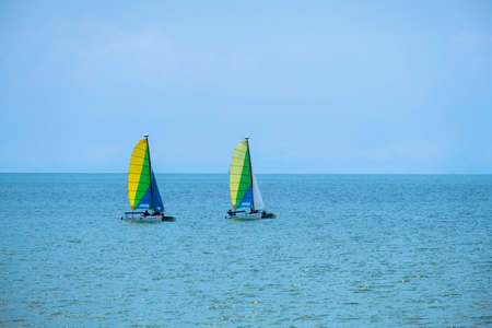 Two sailboats on peaceful  in waters  Imagens