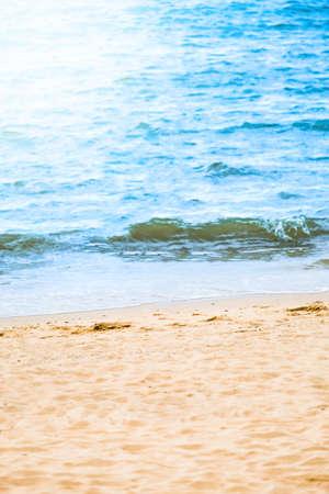 Blue ocean wave on sandy beach