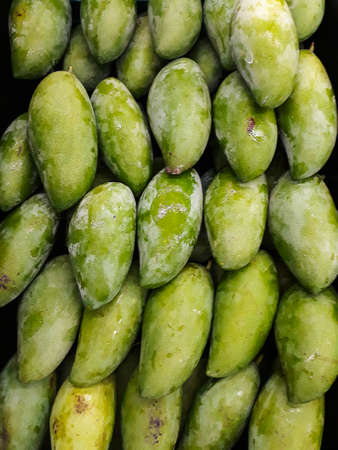 tropical Thai green mango is popular fruit, in basket to protect and keep fresh .