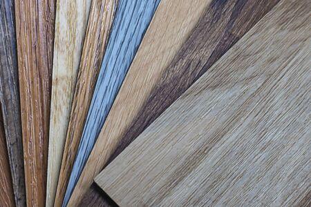 Campione di vinile polimerico in PVC per i clienti di scegliere il design del pavimento all'interno dello spazio della copia Archivio Fotografico