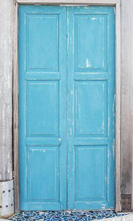 Old blue wooden house door
