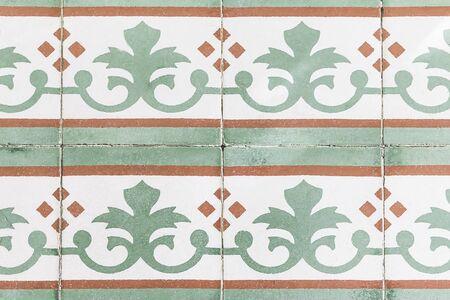 Colorful Vintage Old Ceramic Tiles.Patterned floor tiles Green, orange, white