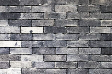 Gray old brick wall background
