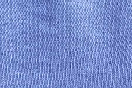 Beautiful blue cotton background made of hand thread