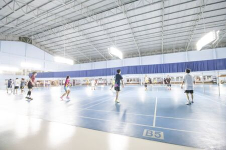 Blurred image of Badminton Court,People playing sports