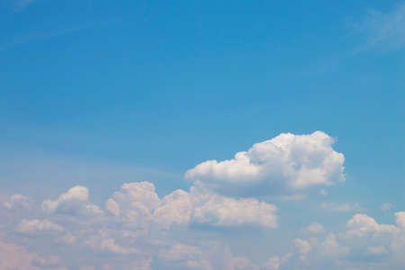 The bright blue sky has soft white clouds