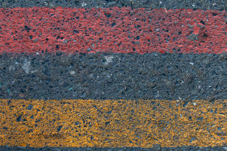 Road background rough painted lines red yellow 免版税图像