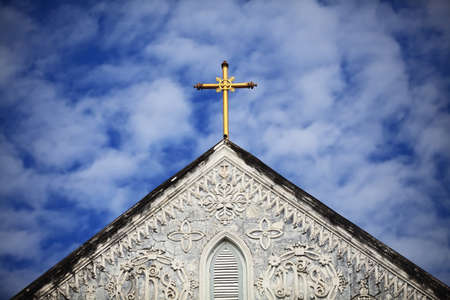 cross on blue sky photo