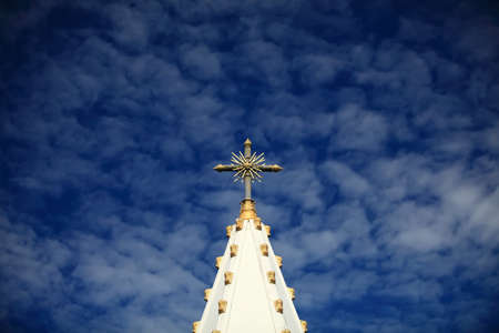 cross on blue sky photo