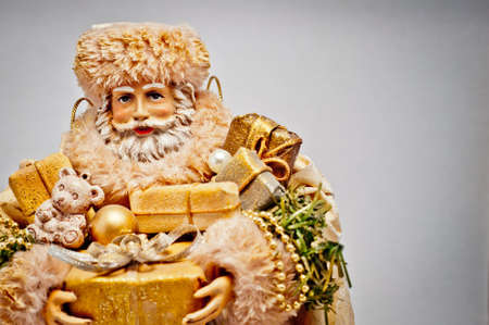 Santa Claus with golden Christmas gifts. With copyspace. photo