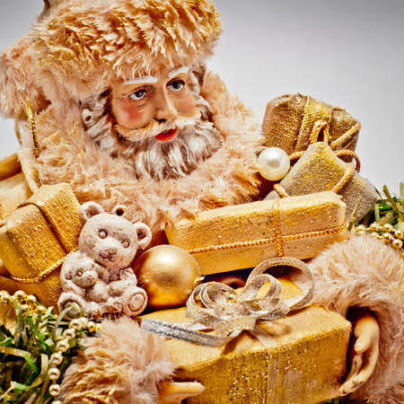 Santa Claus with golden Christmas gifts photo