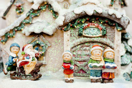 chorus: Christmas choir in front of school singing to Santa Claus.