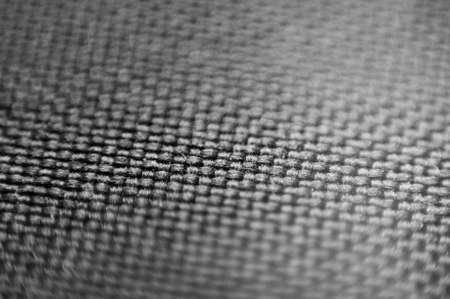 woven surface: Closeup of black synthetic fiber  Shallow dof