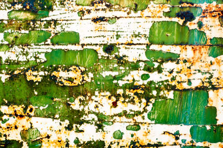 old paint on rusty metal surface  abstract dirty grunge texture background photo