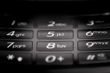 phone number: cell phone keypad close up background. shallow dof