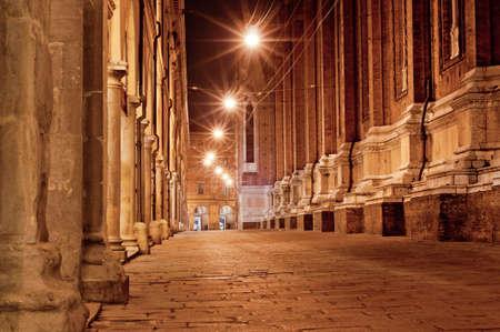 old city street at night. bologna italy