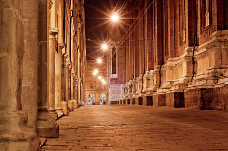 old city street at night. bologna italy photo