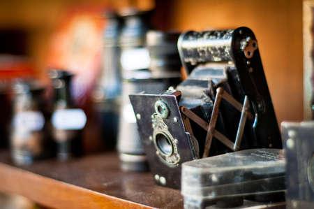 old camera. vintage photography equipments on a shelf. shallow dof. Stock Photo - 13171635