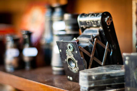 old camera. vintage photography equipments on a shelf. shallow dof. Stock Photo - 13171635