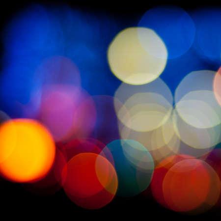 Bokeh sparkling lights background. Blurred defocused lights of city at night. Christmas blurred lights background. Abstract colorful background. photo