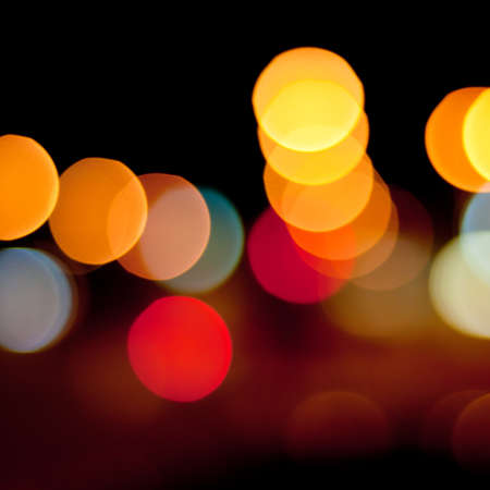 Blurred defocused lights background of city at night. Bokeh sparkling lights. Stock Photo - 17924913