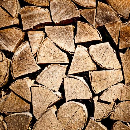fire wood background texture. closeup of chopped fire wood stack Standard-Bild